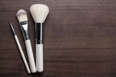 White make-up brushes on brown background Stock Image