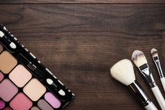 White make-up brushes on wooden background Stock Photo