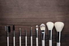 White make-up brushes on wooden background Royalty Free Stock Photos
