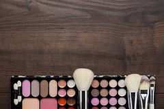 White make-up brushes on wooden background. White make-up brushes on brown wooden background Stock Photography