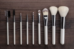 White make-up brushes on wooden table Stock Photo