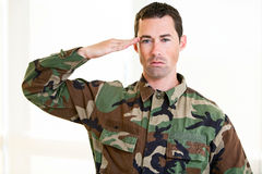 White male in army uniform saluting Stock Photos
