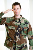 White male in army uniform saluting Royalty Free Stock Images