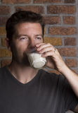 White male drinking glass of milk Stock Photography