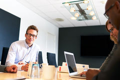 White male executive smiling at camera during meeting Royalty Free Stock Images