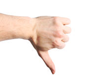 White hand showing a thumbs down sign isolated on white backgrou. White male hand showing a thumbs down sign isolated on white backgrou Royalty Free Stock Images