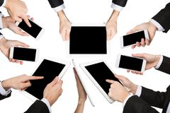 White male hands holding devices and showing symbols. Set of caucasian businessman hands holding tablet and smartphone, showing symbols and gestures, pointing Royalty Free Stock Image
