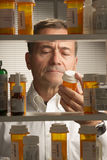 White male with prescription drugs Stock Photo