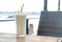 White malt milkshake. On wood table Stock Photo