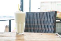 White malt milkshake. On wood table Stock Image
