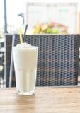 White malt milkshake. On wood table Stock Images