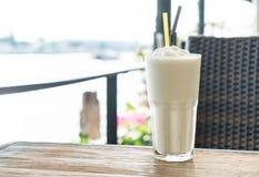 White malt milkshake. On wood table Royalty Free Stock Image