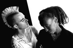 White Man and Black Woman. Portrait of white man with mohawk and black woman with dreadlocks Royalty Free Stock Images