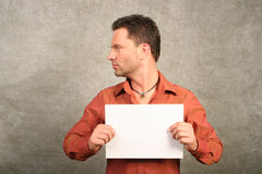 White man with card - space for copy, left Royalty Free Stock Photos
