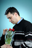 White man choosing red tulips Royalty Free Stock Images