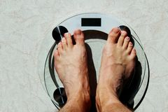 Man feet on a weight scale. White man feet on a weight scale Stock Photography