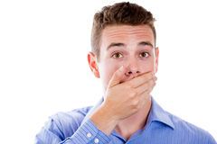 White man with hand over his mouth Stock Photo