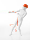 White man with helmet  pulls rope Royalty Free Stock Photos