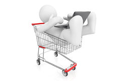 White man with laptop in shopping cart. Royalty Free Stock Photos