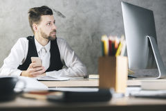 White man looking at computer screen Stock Images