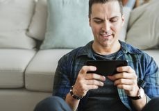 White man playing game in mobile phone royalty free stock photography
