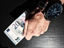 White man`s hand holds a bank note, keep money, money in the palm of your hand, receive money, give money, watch on hand, Europea royalty free stock image