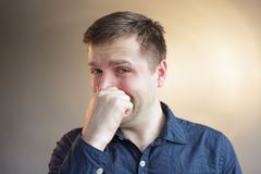 White man in shirt cries because of problems. White man in shirt wipes the tears and cries of pain or sorrow Stock Photos