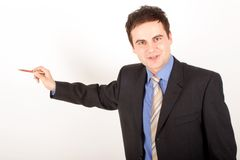 White man in suit, and blue shirt pointing at blank space