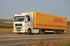 White MAN TGX 18.480 Truck Hauls DHL Trailer Royalty Free Stock Photo