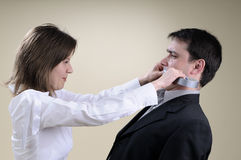 White manager gluing his partner mouth Royalty Free Stock Photo
