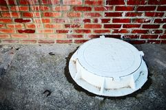 The white manhole Stock Images
