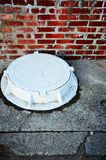 The white manhole. vertically Royalty Free Stock Images