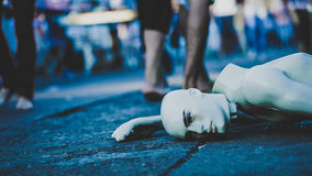 White Mannequin Lying on Street Stock Photography