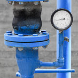 White manometer on blue pipe Stock Photos