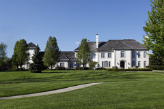 White mansion in suburbs Royalty Free Stock Images