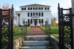 White Mansion with walkway Royalty Free Stock Photography