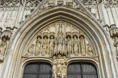 A white marble arch with christian saints sculpted above the ent. Rance in Brussels, Belgium, Europe on a bright summer day Royalty Free Stock Image