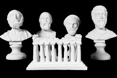 White marble bust of ancient greeks. (Homer, Socrates, Sophocles, Pythagoras) and acropolis on black background Stock Photography