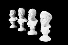 White marble bust of ancient greeks. (Homer Sophocles, Pythagoras, Socrates) on black background Stock Images