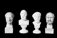 White marble bust of ancient greeks. (Socrates, Dimokritos, Aristoteles, Pythagoras) on black background Royalty Free Stock Photo