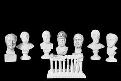 White marble bust of ancient greeks. (Sophocles, Dimokritos, Homer, Pericles, Aristoteles, Socrates, Pythagoras) and acropolis on black background Royalty Free Stock Photography