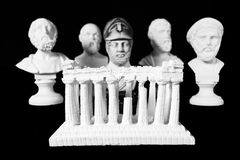 White marble bust of ancient greeks. (Sophocles, Homer, Pericles, Socrates, Pythagoras) and acropolis on black background Royalty Free Stock Photo