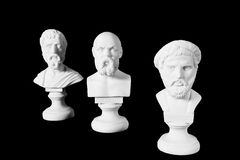 White marble bust of ancient greeks. (Sophocles, Pythagoras, Socrates) on black background Royalty Free Stock Photos