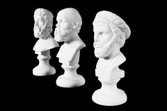 White marble bust of ancient greeks. (Sophocles, Pythagoras, Socrates) on black background Royalty Free Stock Image