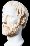 White marble bust of the greek philosopher Aristoteles,. White marble bust of the greek philosopher Aristotle, isolated on black stock photo