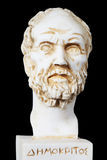White marble bust of the greek philosopher Democritus. Isolated on black royalty free stock photo