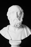 White marble bust of the greek poet Homer isolated on black Royalty Free Stock Photography