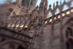 White marble construction on the roof of famous Cathedral Duomo di Milano, piazza in Milan, Italy. Blur and movement Royalty Free Stock Image