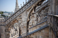 White marble construction on the roof of famous Cathedral Duomo di Milano, piazza in Milan, Italy. Sunny day Royalty Free Stock Images