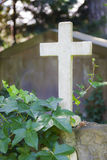 White marble cross on catholic grave. Royalty Free Stock Images